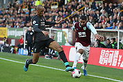 Liverpool midfielder Fabinho (3) wins the tackle against  Burnley midfielder Aaron Lennon (25) during the Premier League match between Burnley and Liverpool at Turf Moor, Burnley, England on 31 August 2019.