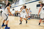 Mount Mansfield forward Devyn Beliveau-Gale (20) takes the court during player introductions before the start of the girls basketball game between the Rice Green knights and the Mount Mansfield Cougars at MMU High School on Friday night December 4, 2015 in Jericho. (BRIAN JENKINS/for the FREE PRESS)