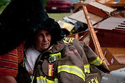 A Ben Wheeler FD firefighter covers the survivor of a twister that completely destroyed her mobile home on FM 4207 east of town on Tuesday. She was shaken and had some minor bruises but otherwise escaped without serious injuries. A line of dangerous storms hit East Texas spawning a number of tornados in the area.© 2011 Jaime R. Carrero/Tyler Morning Telegraph