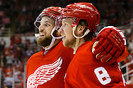 Mar 9, 2015; Detroit, MI, USA; Detroit Red Wings left wing Justin Abdelkader (8) receives congratulations from center Riley Sheahan (15) after scoring an open net goal in the third period against the Edmonton Oilers at Joe Louis Arena. Detroit won 5-2. Mandatory Credit: Rick Osentoski-USA TODAY Sports