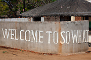 Welcome To So What sign on wall, Tambala Village, Malawi