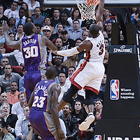 17 November 2010: Miami Heat's shooting guard #3 Dwyane Wade dunks the ball during the Miami Heat 123-96 victory over the Phoenix Suns at the AmericanAirlines Arena, Miami, Florida, USA.