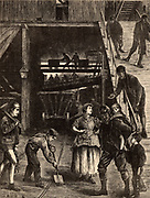 Pithead scene showing men and boys coming up from an underground shift. Note the female and child pithead workers. South Durham Coalfield, England. Engraving from 'The Graphic' (London, 22 February 1871).