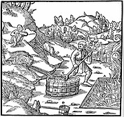 Producing salt by evaporating natural brine by pouring it into a pit of burning charcoal. A rather impure product resulted. From Agricola 'De re metallica', Basel, 1556. Woodcut