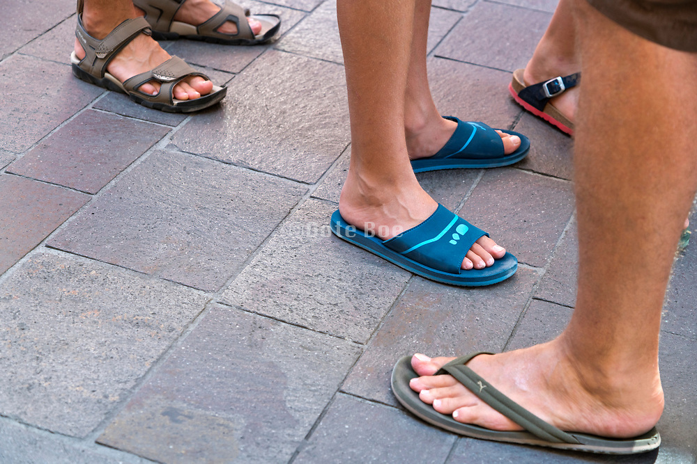 summer tourists wearing flip flops