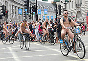 """Naked Bike Ride<br /> Protest through Central London, Great Britain<br /> 14th June 2014<br /> Protestors ride their bikes naked through the streets of London<br /> The World Naked Bike Ride (WNBR) is an international clothing-optional bike ride in which participants plan, meet and ride together en masse on human-powered transport (the vast majority on bicycles, but some on skateboards and inline skates), to """"deliver a vision of a cleaner, safer, body-positive world.<br /> <br /> Photograph by Elliott Franks"""