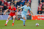 Middlesbrough midfielder Grant Leadbitter (7) and Sunderland midfielder Callum McManaman (13) in action  during the The FA Cup 3rd round match between Middlesbrough and Sunderland at the Riverside Stadium, Middlesbrough, England on 6 January 2018. Photo by Simon Davies.
