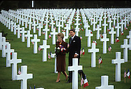 President Reagan and First Lady Nancy Reagan walk through the graves at the US cemetary in Normandy on the fortieth anniversary of D Day...Photograph by Dennis Brack bb 27