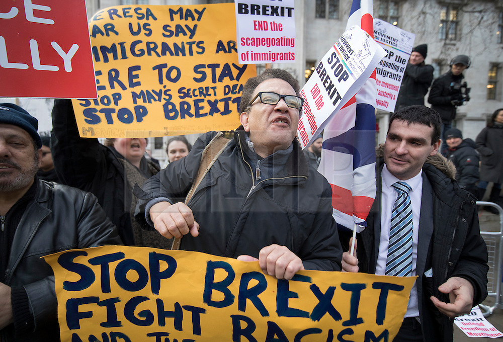 © Licensed to London News Pictures. 05/12/2016. London, UK. An anti-Brexit demonstrator protests outside the Supreme Court in Westminster, London on the first day of a Supreme Court hearing to appeal against a November 3 High Court ruling that Article 50 cannot be triggered without a vote in Parliament. Photo credit: Peter Macdiarmid/LNP