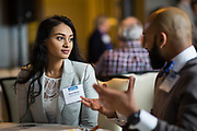 Rayna Sparkes (left) and Mitesh Patel (right) socialize during the Business of Cannabis event at the Silicon Valley Capital Club in San Jose, California, on April 4, 2019. (Stan Olszewski for Silicon Valley Business Journal)