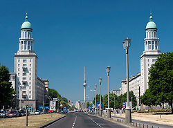 View along Karl Marx Allee towards Frankfurter Tor and TV Tower at Alexanderplatz in Berlin Germany