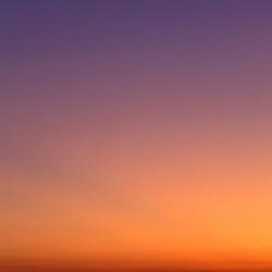 Deep Creek SRA, Ninilchik, AK. Redoubt Volcano. Sunset.  Across Cook Inlet.  Mt. Redoubt bathes in the summer sun.