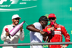 October 22, 2017 - Austin, Texas, U.S - Usain Bolt and Mercedes driver Lewis Hamilton (44) of Great Britain on the podium after the Formula 1 United States Grand Prix race at the Circuit of the Americas race track in Austin,Texas. (Credit Image: © Dan Wozniak via ZUMA Wire)