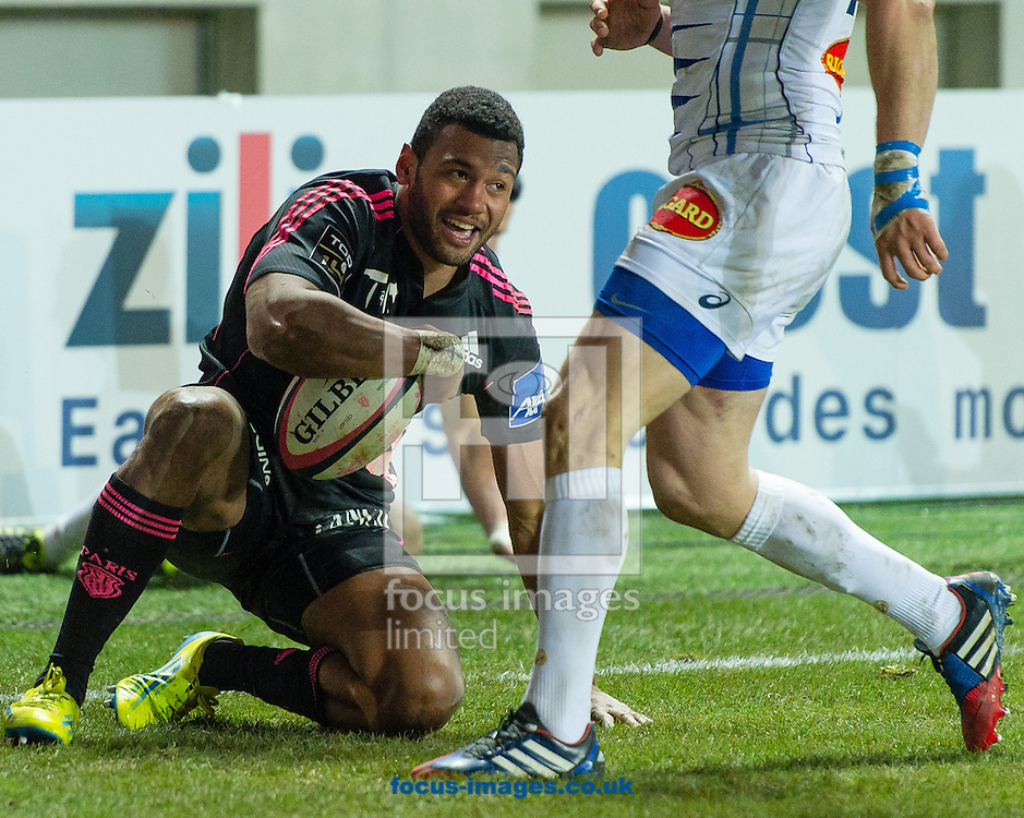 Picture by Andrew McLean Brown/Focus Images Ltd + 33 670 67 8592<br /> 24/01/2014<br /> Waisea Vuidarvuwalu of Stade Francais scores a try with Marcel Garvey of Castres Olympique right behind him during the Top 14 match at Stade Jean Bouin, Paris.