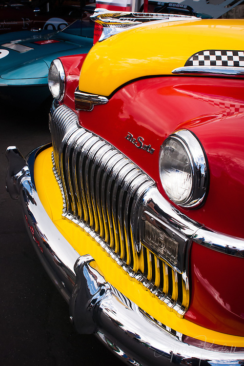 A colorful DeSoto in the paddock at Laguna Seca during the Rolex Monterey Motorsports Reunion 2013