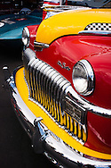 A colorful DeSoto in the paddock at Laguna Seca at the Rolex Monterey Motorsports Reunion during Monterey Car Week