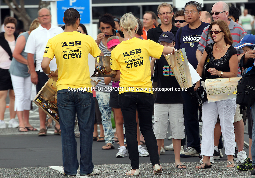 ASB staff hand out posters for tennis fans at the Viaduct, Auckland, New Zealand, Thursday, December 30, 20100. Photo: Andrew Cornaga/photosport.co.nz