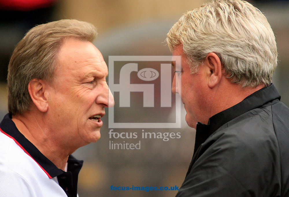 Steve Bruce Manager  (right) of Hull City greets Neil Warnock of Crystal Palace during the Barclays Premier League match at KC Stadium, Hull<br /> Picture by Richard Gould/Focus Images Ltd +44 7855 403186<br /> 04/10/2014