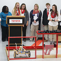 Lauren Wood | Buy at photos.djournal.com<br /> Sarah Hoing tells everyone about the South Pontotoc High School team's building process as Makenna Cowsert, right, maneuvers their robot through the quadrant Thursday during the BEST robotics lunch at Toyota Motor Manufacturing Mississippi.