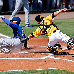 Mar 13, 2013; Bradenton, FL, USA; Toronto Blue Jays right fielder Anthony Gose (8) slides past Pittsburgh Pirates catcher Russell Martin (55) for a score during the top of the first inning of a spring training game at McKechnie Field. Mandatory Credit: Derick E. Hingle-USA TODAY Sports