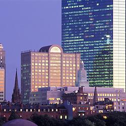 Back Bay skyline featuring John Hancock tower at dusk, Boston, MA.