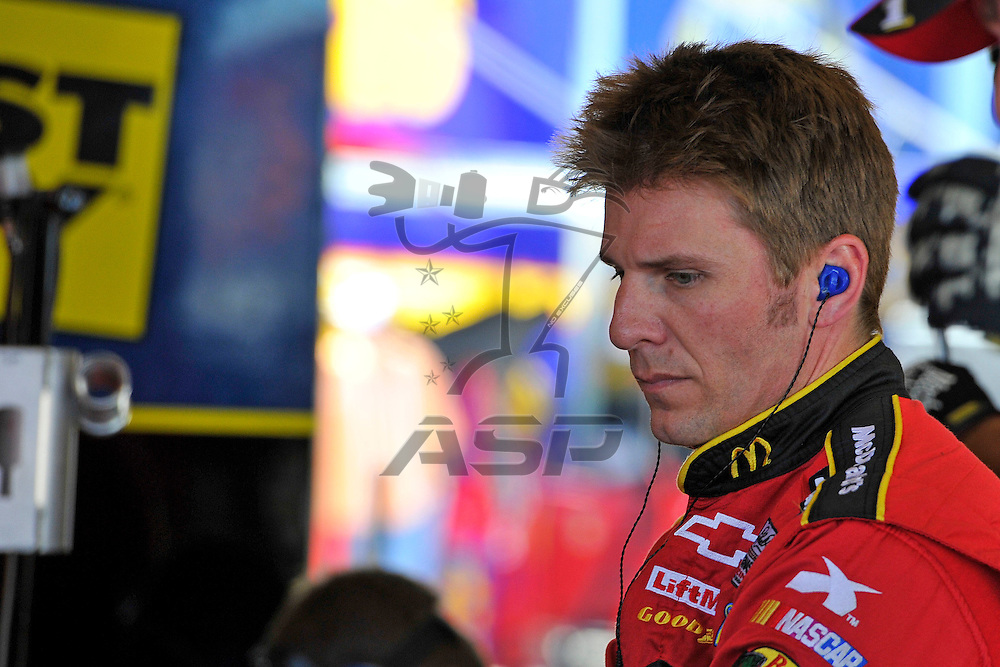 Joliet, IL - SEP 14, 2012: Jamie McMurray (1) stands by his car in the garage during practice for the Geico 400 at the Chicagoland Speedway in Joliet, IL.