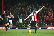Brentford striker Lasse Vibe (21) scoring his second and Brentfords third 3-0 during the EFL Sky Bet Championship match between Brentford and Aston Villa at Griffin Park, London, England on 31 January 2017. Photo by Matthew Redman.