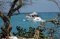A private boat cruises just off the coast of Isla Grande, one of the islands in an archipelago known as Islas del Rosario, about 35km southwest of Cartagena, on Colombia's Caribbean coast on January 2, 2009. (Photo/Scott Dalton)