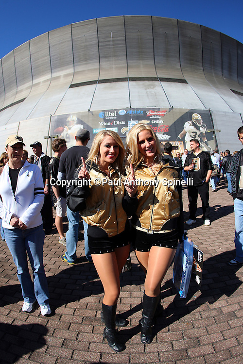 NEW ORLEANS - DECEMBER 07: Two New Orleans Saints cheerleaders pose for a photo outside the stadium before the game against the Atlanta Falcons at the Louisiana Superdome on December 7, 2008 in New Orleans, Louisiana. The Saints defeated the Falcons 29-25. ©Paul Anthony Spinelli