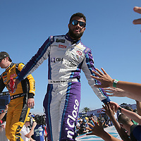 Darrell Wallace Jr. high fives fans during driver introductions for the 60th Annual NASCAR Daytona 500 auto race at Daytona International Speedway on Sunday, February 18, 2018 in Daytona Beach, Florida.  (Alex Menendez via AP)