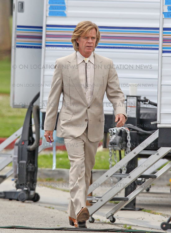 """April 14th, 2010 Los Angeles, CA. ***Exclusive*** Milla Jovovich and William H. Macy are the bride and groom as they prepare to film a wedding scene together for """"Bad Girl"""" starring British actress Juno Temple who was seen hanging out by her trailer. Macy was spotted brushing his teeth before going to set and kissing Jovovich in the wedding scene. Macy was also seen playing a miniture guitar during filming breaks. Photo by Eric Ford/ On Location News. 818-613-3955. info@onlocationnews.com"""