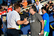 Oxford United manager Karl Robinson and Leeds United manager Marcelo Bielsa  shake hands before the Pre-Season Friendly match between Oxford United and Leeds United at the Kassam Stadium, Oxford, England on 24 July 2018. Picture by Graham Hunt.