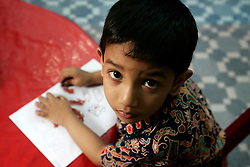 BANGLADESH CHITTAGONG 9MAR05 - A child draws during a playgroup session at Bay View private School in Chittagong. The school, directed by Mrs Mendes, is one of the best providing high quality secondary education in Bangladesh...jre/Photo by Jiri Rezac..© Jiri Rezac 2005..Contact: +44 (0) 7050 110 417.Mobile:  +44 (0) 7801 337 683.Office:  +44 (0) 20 8968 9635..Email:   jiri@jirirezac.com.Web:    www.jirirezac.com..© All images Jiri Rezac 2005 - All rights reserved.