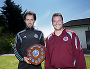 - St James' captain Dale Hart (left) recieves the Dundee Saturday Morning Football League First Division trophy from League President Iain Leith at Fairmuir, Dundee<br /> <br /> <br />  - &copy; David Young - www.davidyoungphoto.co.uk - email: davidyoungphoto@gmail.com