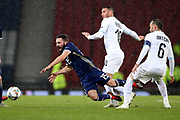 Scotland midfielder Graeme Shinnie (15) (Aberdeen) is fouled by Tomer Hemed (10) (Queens Park Rangers)of Israel during the UEFA Nations League match between Scotland and Israel at Hampden Park, Glasgow, United Kingdom on 20 November 2018.