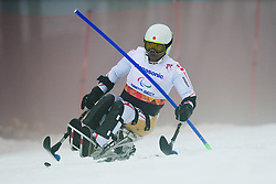 Akira TANIGUCHI competing in the Alpine Skiing Super Combined Slalom at the 2014 Sochi Winter Paralympic Games, Russia