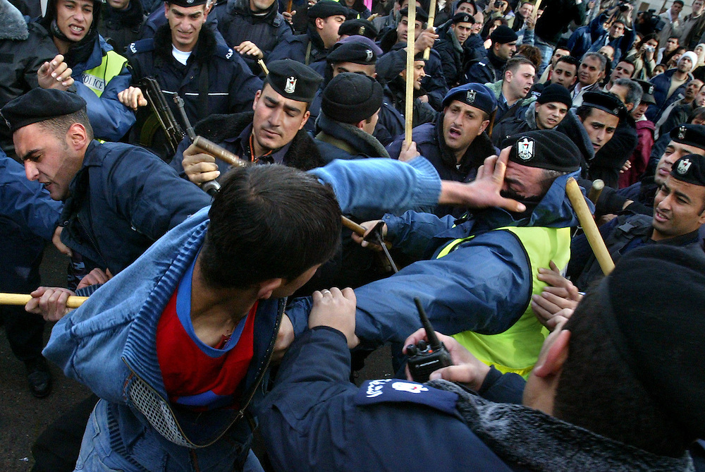 Palestinians clash with palestinian police officers during emo in Ramallah...Photo by Olivier Fitoussi