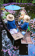 Women selling goods from their boats in Bangkok, Thailand.