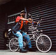 Man sitting on his Schwinn bike