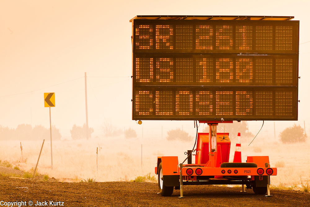 "04 JUNE 2011 - EAGAR, AZ: Highway 261 south of 260 has been closed because of the Wallow Fire. The fire grew to more than 140,000 acres early Saturday with zero containment. A ""Type I"" incident command team has taken command of the fire.   PHOTO BY JACK KURTZ"