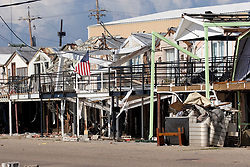 03 Oct, 2005.  New Orleans, Louisiana.  Hurricane Katrina aftermath.<br /> Remnants of the lake front homes at the Southern Yacht Club on the shores of Lake Pontchatrain in Lakeshore, New Orleans.<br /> Photo; ©Charlie Varley/varleypix.com