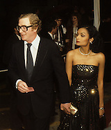Michael Caine and his wife Shakira arrive at the 20th Century Fox party for the Queen, during Queen Elizabeth II visit to California in March 1983...Photograph by Dennis Brack b23