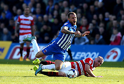 Lewis Alessandra of Hartlepool United is fouled by Luke McCullough of Doncaster Rovers - Mandatory by-line: Robbie Stephenson/JMP - 06/05/2017 - FOOTBALL - The Northern Gas and Power Stadium (Victoria Park) - Hartlepool, England - Hartlepool United v Doncaster Rovers - Sky Bet League Two
