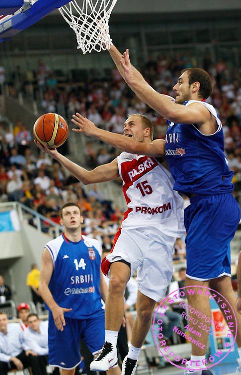 Wroclaw 12/09/2009.EuroBasket 2009.Qualifying Round - Group F.Poland v Serbia.Lukasz Koszarek of Poland and Nenad Krstic of Serbia ..Photo by : Piotr Hawalej / WROFOTO