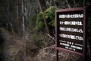 A sign pleads to to those people contemplating suicide to think again and seek advice from friends or family before taking their life at the entrance of Aokigahara Jukai, better known as the Mt. Fuji suicide forest, which is located at the base of Japan's famed mountain west of Tokyo, Japan. ..