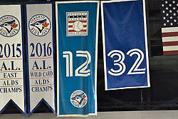 March 29, 2018 - Toronto, ON, U.S. - TORONTO, ON - MARCH 29: No. 32 is unrolled high in the rafters in a ceremony honoring the late pitcher Roy Halladay by retiring his No. 32 on opening day before the MLB season game between the New York Yankees and the Toronto Blue Jays at Rogers Centre in Toronto, ON., Canada March 29, 2018. Jays players will also wear a no. 32 patch on their jerseys throughout the season in tribute to Halladay. Halladay, nicknamed 'Doc' who spent 12 seasons as a pitcher with the Jays, died in November 2017 when his personal plane crashed into the Gulf of Mexico near Tampa. He was 40 years old. Halladay joins Robero Alomar (no. 12) as the only 2 players in Jays history to have their jersey numbers retired. (Photo by Jeff Chevrier/Icon Sportswire) (Credit Image: © Jeff Chevrier/Icon SMI via ZUMA Press)