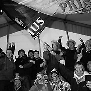 Some race fans are content to spend the entirety of the day in the crowded beer tents, where allegiances are boldly presented in costume, music, and  booze-soaked debate. Though the tents are located adjacent the course, many never see the race action except perhaps on television screens.