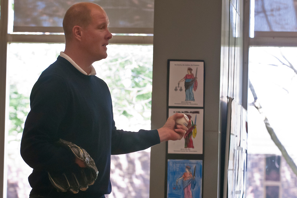 Lathan Goumas | MLive.com..May 5, 2012 - Former professional baseball pitcher Jim Abbott demonstrates how he would take his glove on and off while speaking to a group of people on Saturday at the Flint Public Library in Flint, Mich. Abbott was born with out a right hand and had to throw and catch with the same hand when playing baseball.