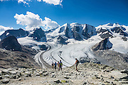 """From Diavolezza cable car station, admire tremendous views of the icy Bernina Range, in Switzerland, Europe. Above Pers Glacier rise Piz Palü (3900 m on left), Piz Zupò (3996 m), in the Swiss canton of Graubünden (or Grisons / Grigioni / Grischun). If not afraid of heights at Diavolezza, don't miss the magnificent hike to rocky Munt Pers (gaining 265 meters over just 4 km round trip). The Swiss valley of Engadine translates as the """"garden of the En (or Inn) River"""" (Engadin in German, Engiadina in Romansh, Engadina in Italian) and is part of the Danube basin."""