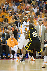 Tennessee Volunteers guard JaJuan Smith (2) is guarded by Long Beach State 49ers guard Kevin Houston (20).  The #5 seed Tennessee Volunteers defeated the #12 seed Long Beach State 49ers 121-86  in the first round of the Men's NCAA Tournament in Columbus, OH on March 16, 2007.